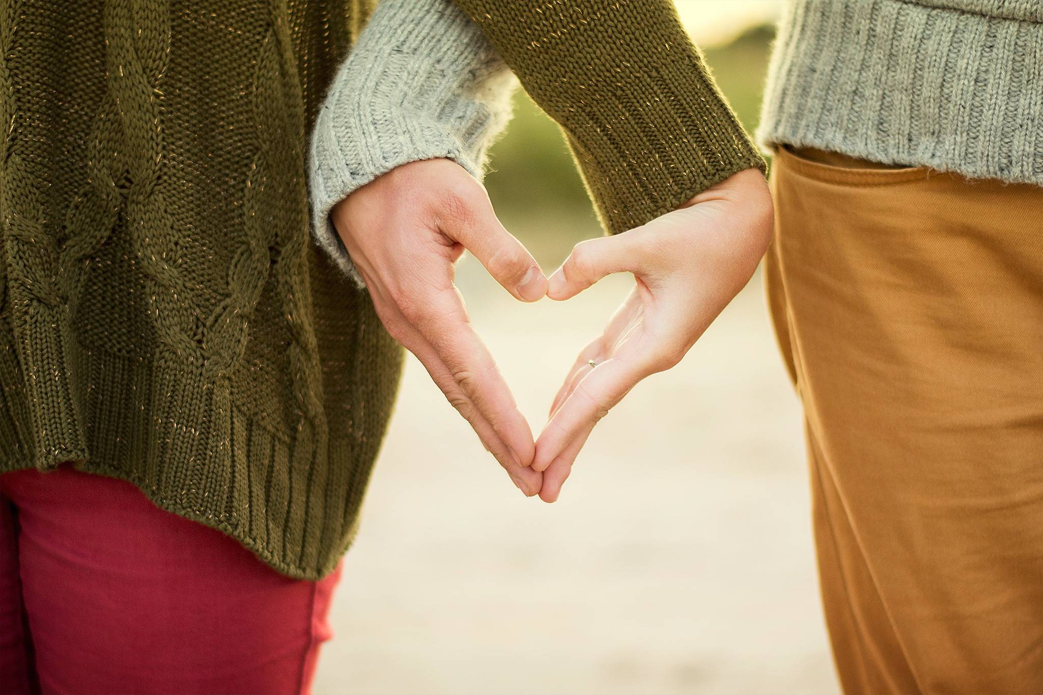 Two People Making Heart Shape With Hands