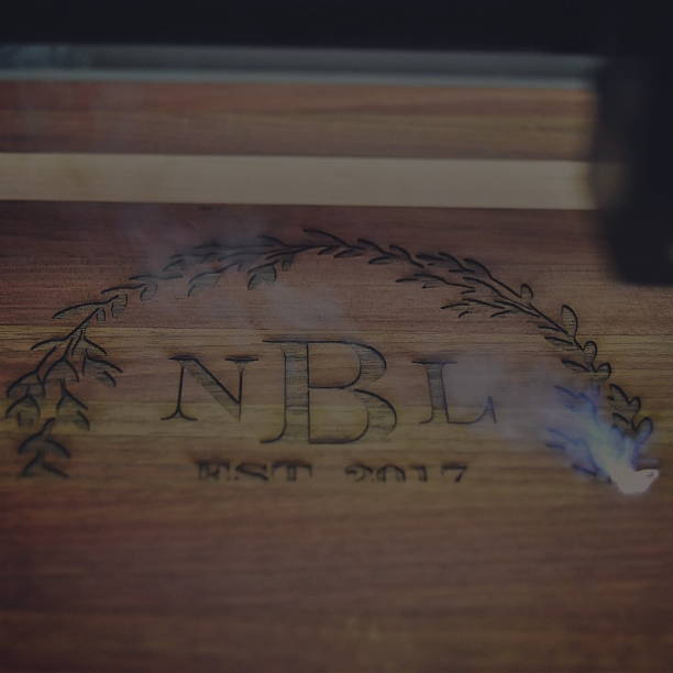 A laser engraving a wood cutting board.