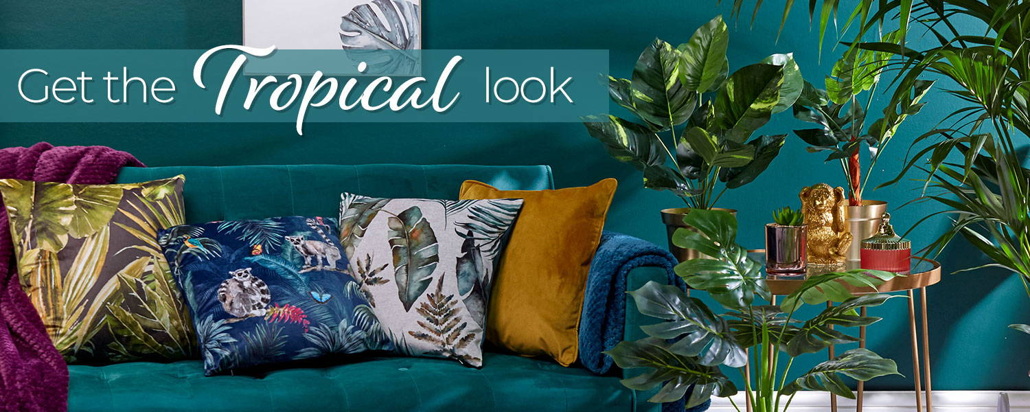 Tropical home furnishings, cushions, throws and plants