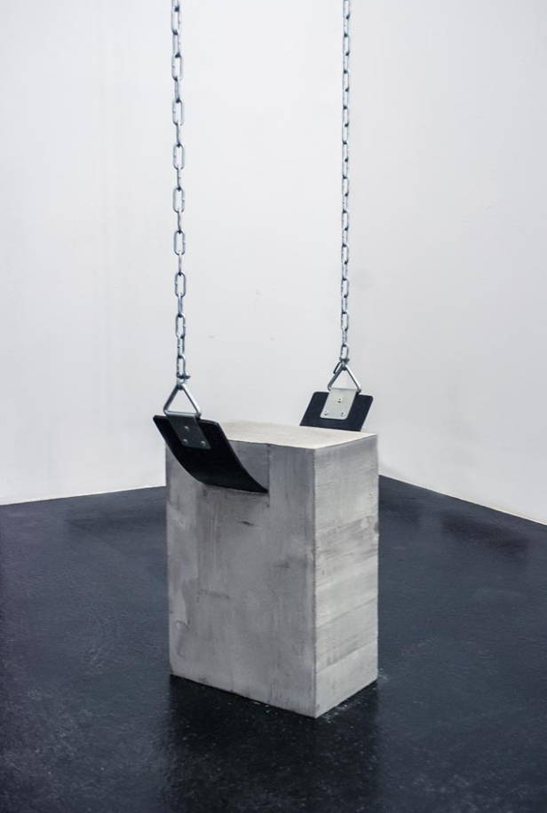 Swing attached to a concrete block