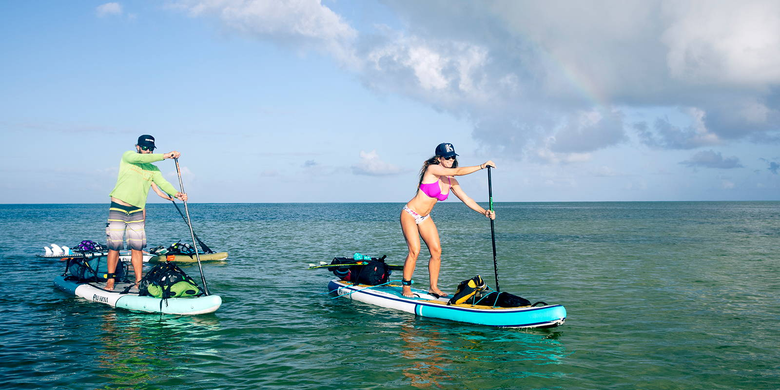 summer paddle boarding session in bikinis and boardshorts