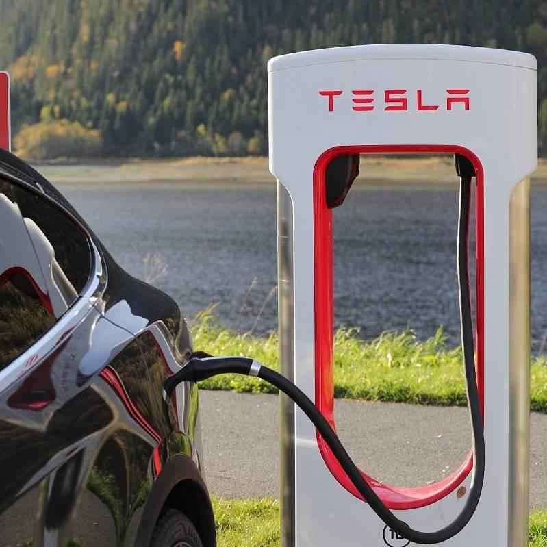 An electric Tesla car charging