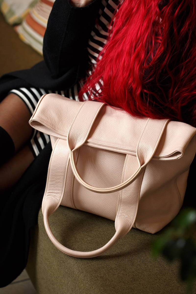 women tote in powder pink leather image