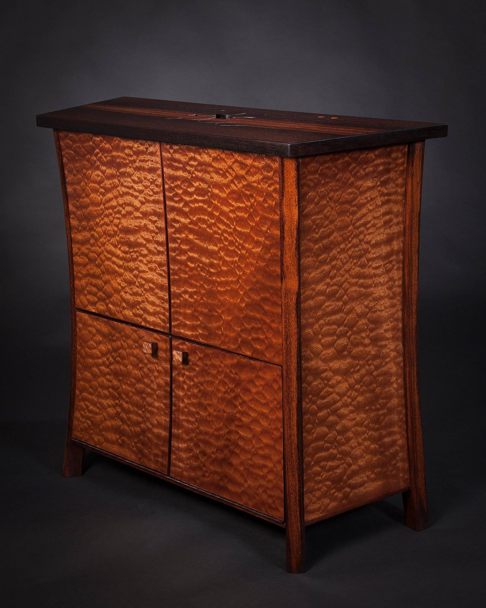 Cabinet with wooden tongue drum top