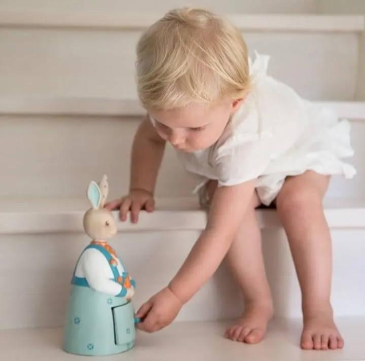 toddler with rabbit toys by Bello designer strore wellington