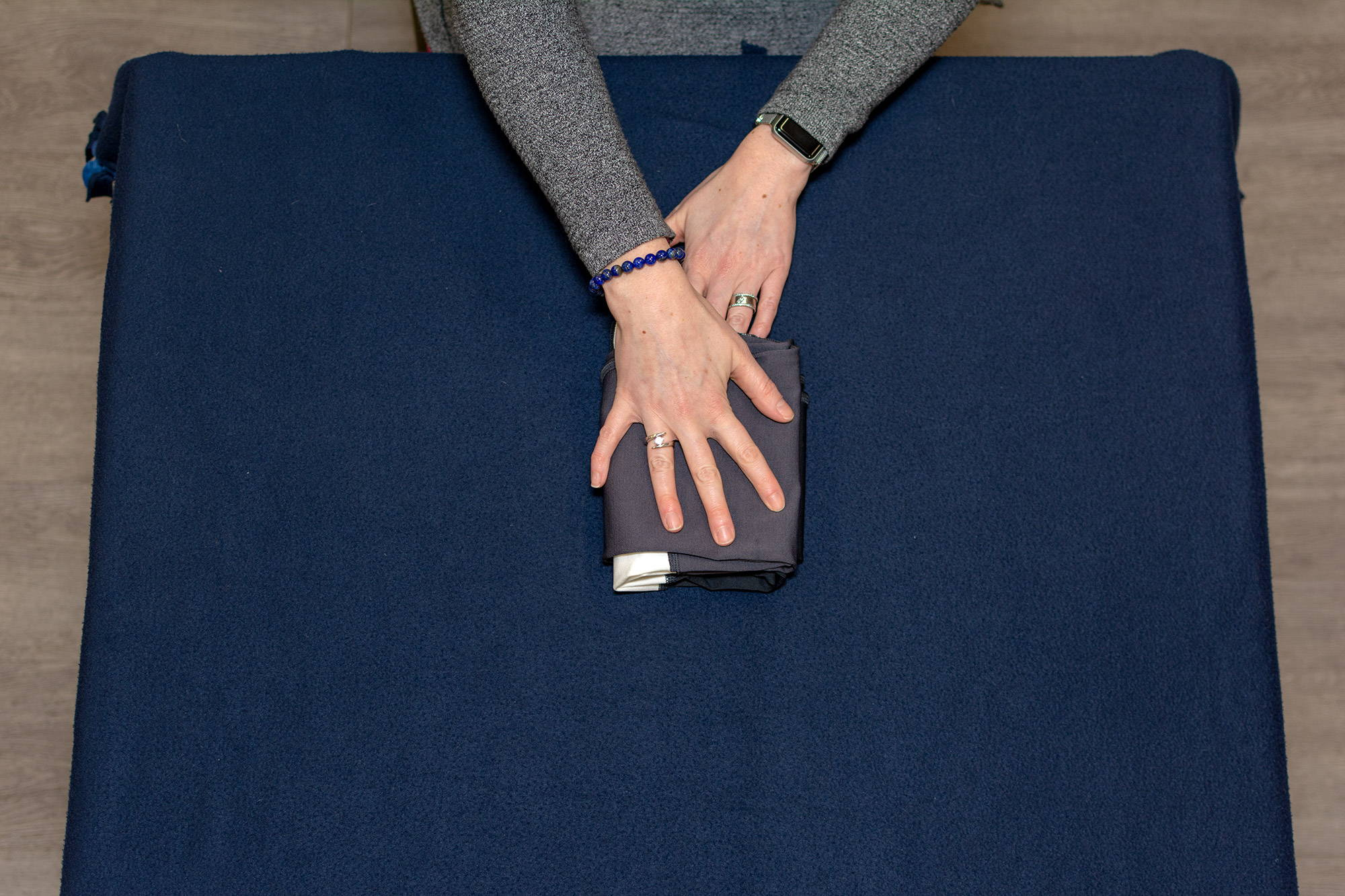 hands folding leggings