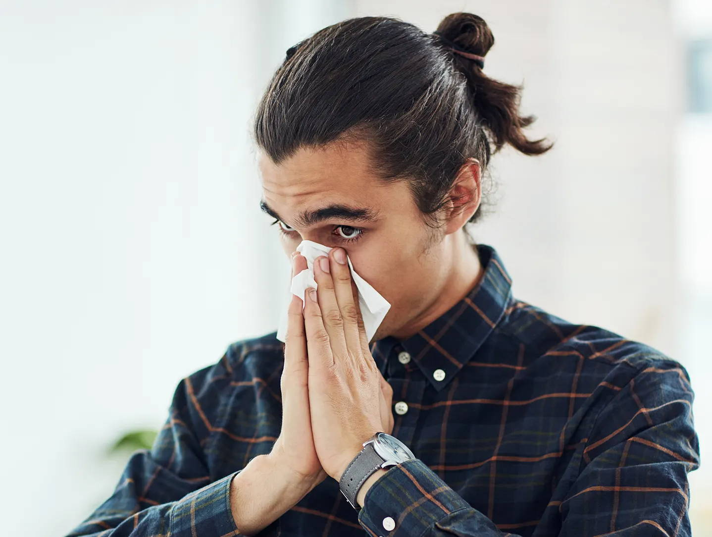 Young man with allergic rhinitis