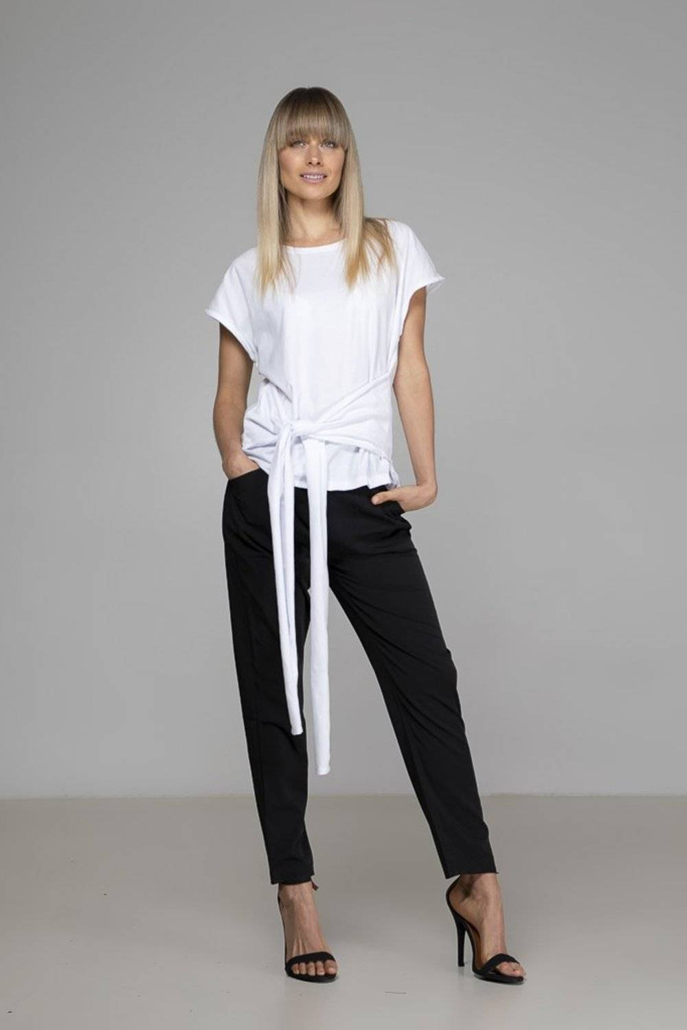 The White Tie Top from Indecisive is a soft organic cotton tee that blurs the line between casual & sophisticated with its feature waist tie.