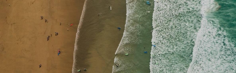 An aerial photo of a surf beach