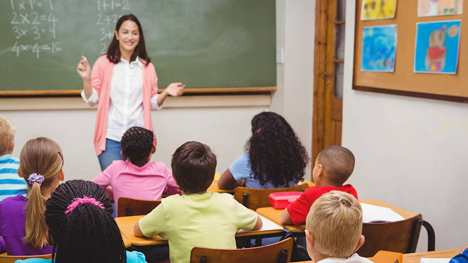 Teacher in front of students - Helix offers discounts to teachers