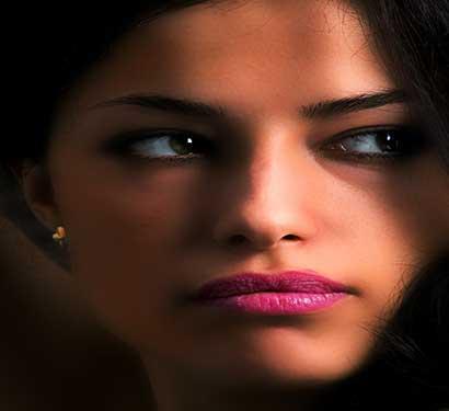 Olive skin wearing London Primrose Petals pink lipstick by Plum & York