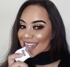nz girl sexy smile with teeth whitening led light in hand