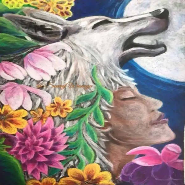 Savannah Corbett's (mystical creature) winning piece is titled Wolf Woman 2018 and is oil pastel on black paper. The image is of Savannah's head underneath a wolfs head, surrounded by beautiful flowers and a full moon shining in the background.
