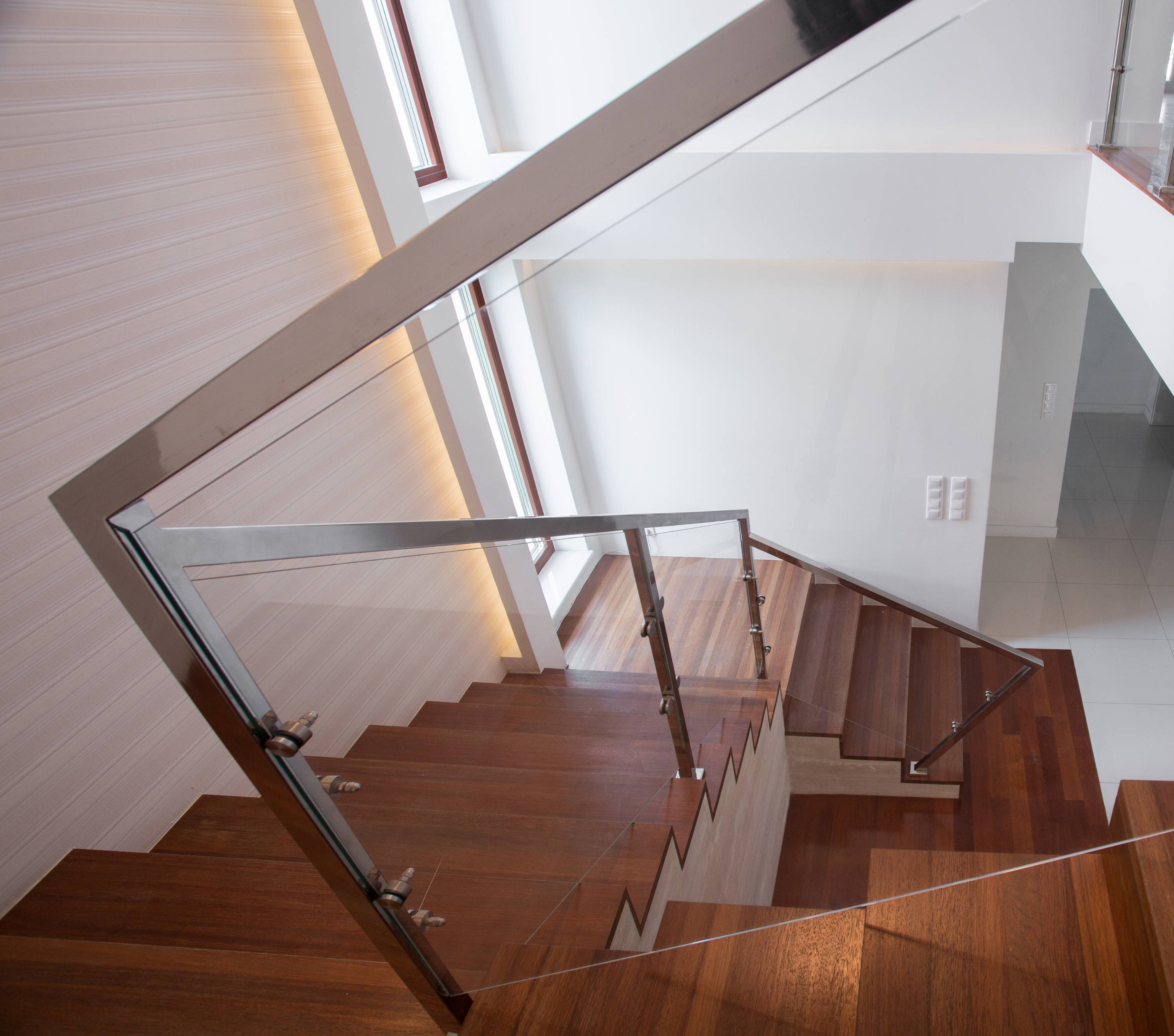 Glass railing with chrome handrails
