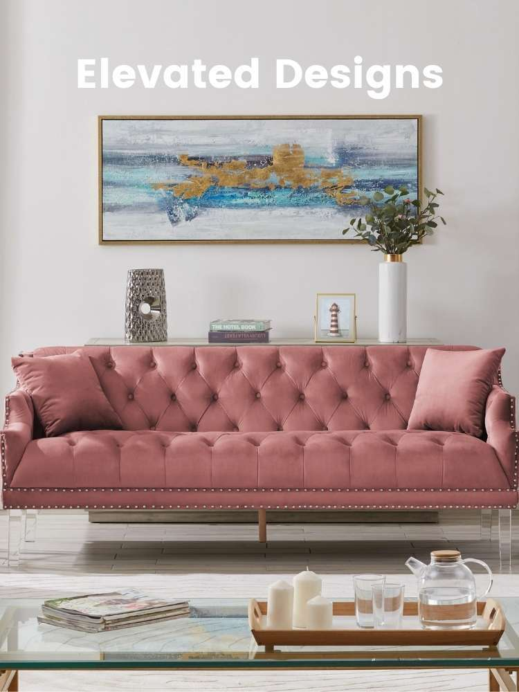A living space with a blush Iconic Home Elsa velvet sofa in the middle