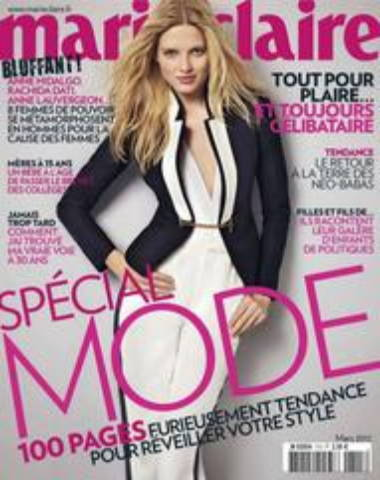 Marie Claire magazine cover, woman standing in white dress and black blazer with long blonde hair