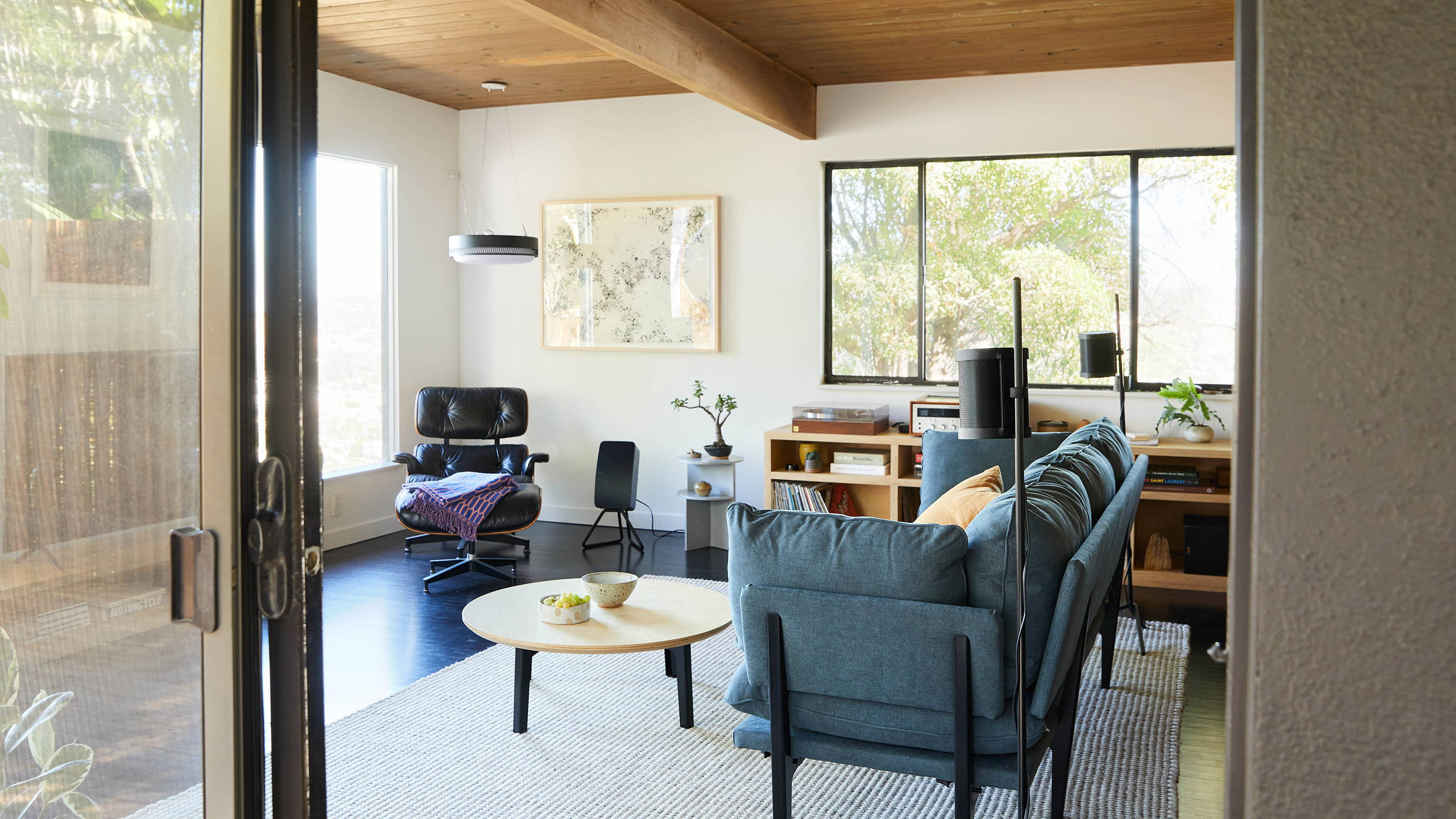 A wide view of a modern room with Floyd furniture and Sonos speakers.