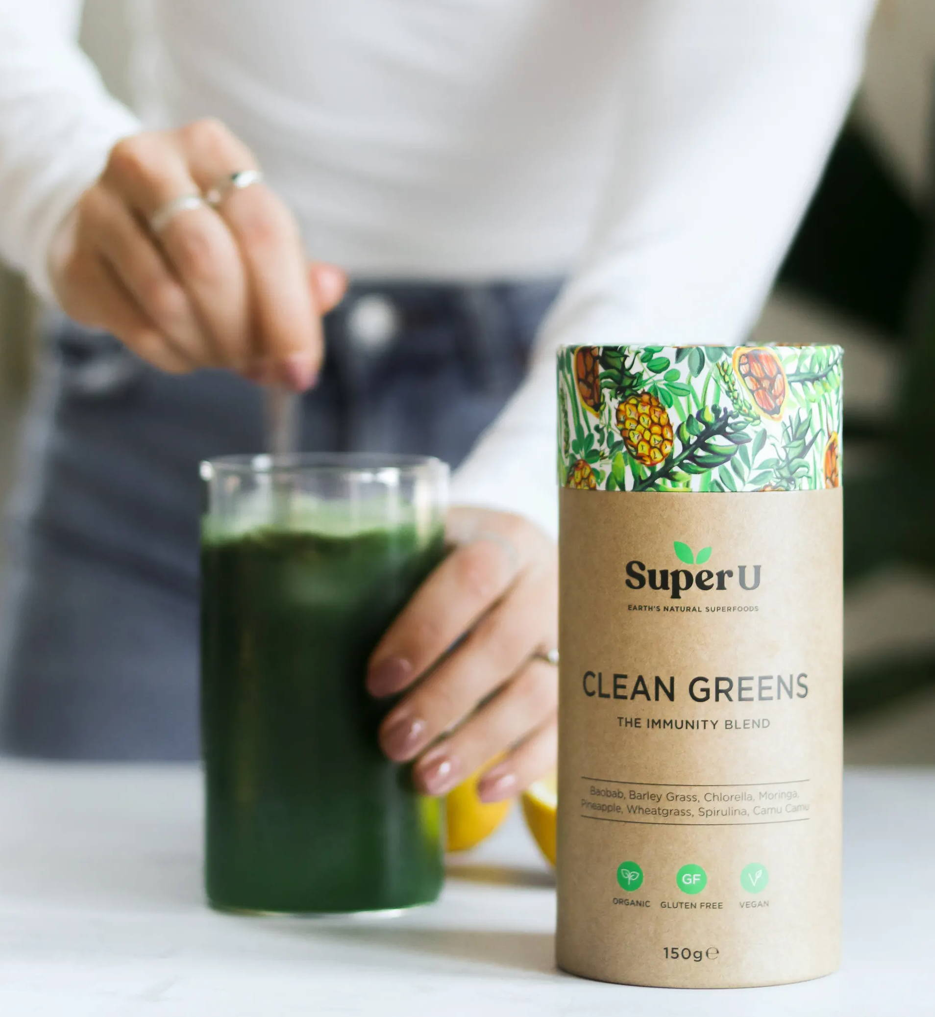 Mixing a greens powder with water to boost the immune system