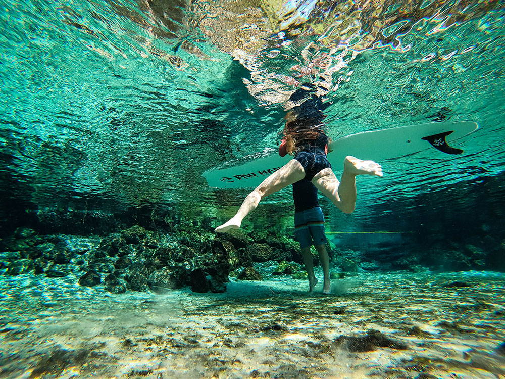underwater picture of a swimmer and SUP