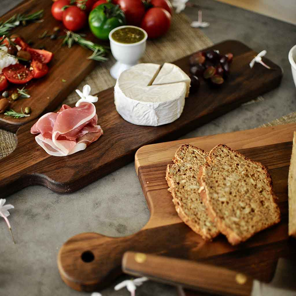Our cutting boards come in many shapes in sizes - rectangular, round, with handle, without handle and more