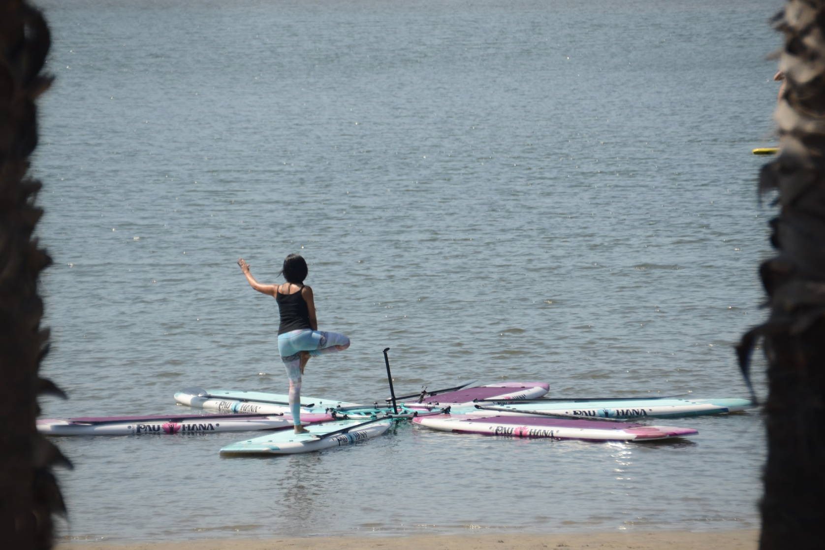Solo yoga standing tree pose on the water