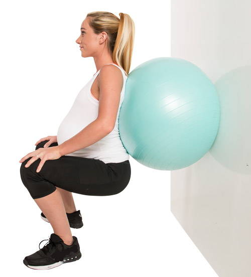 Low squat birthing ball exercise