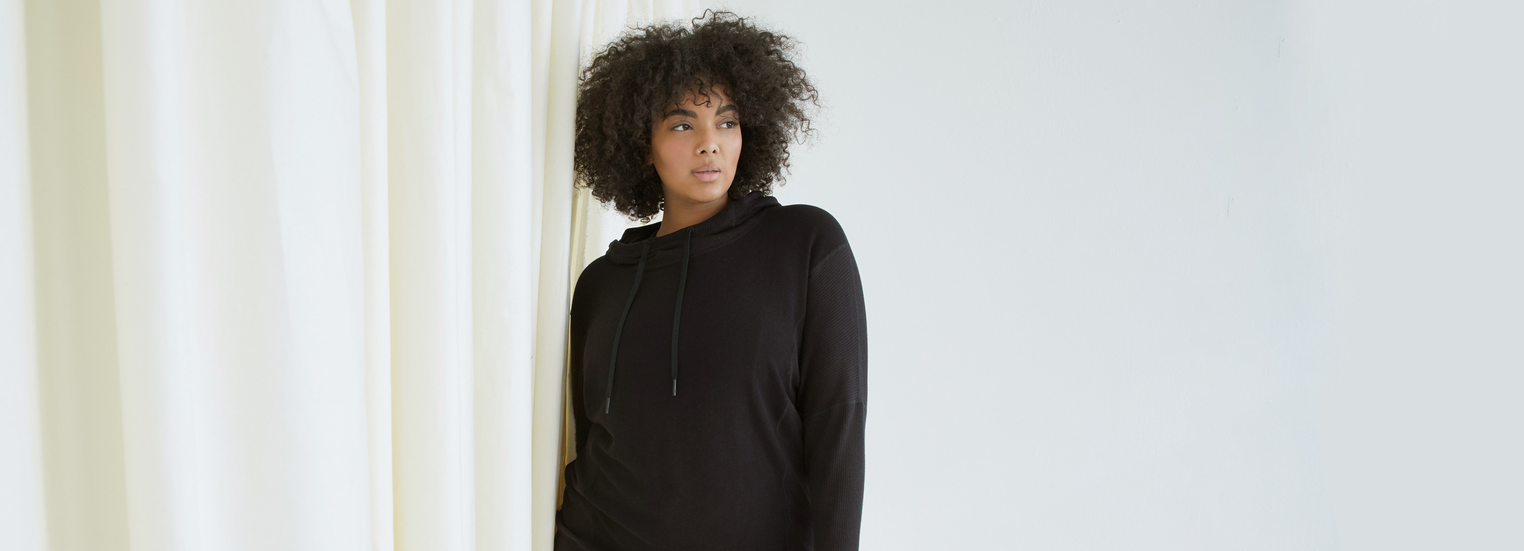 Shop Luxe Lounge. Featuring our Rise Dolman in Black.