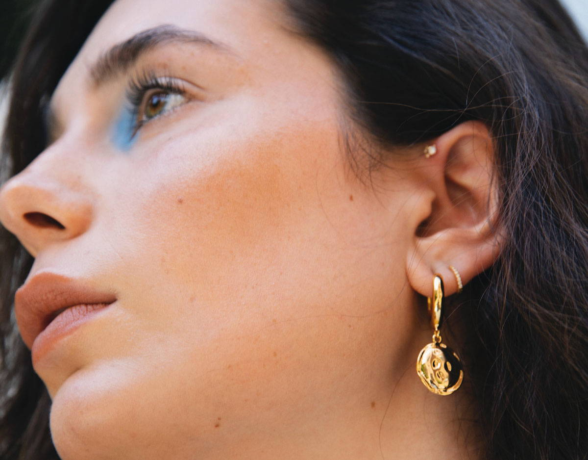 coin pendant chunky hoops worn on model