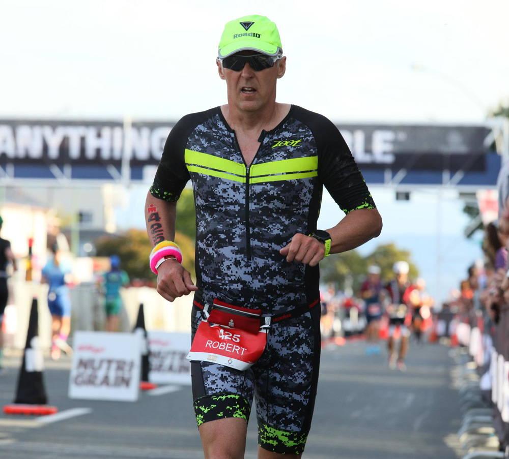 Male athlete running on Ironman NZ course