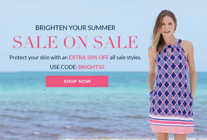 Woman wearing Navy Geo Sleeveless Shift Dress on beach. Extra 50% Off Sale Section with code BRIGHT50. Shop this sale on sale now!
