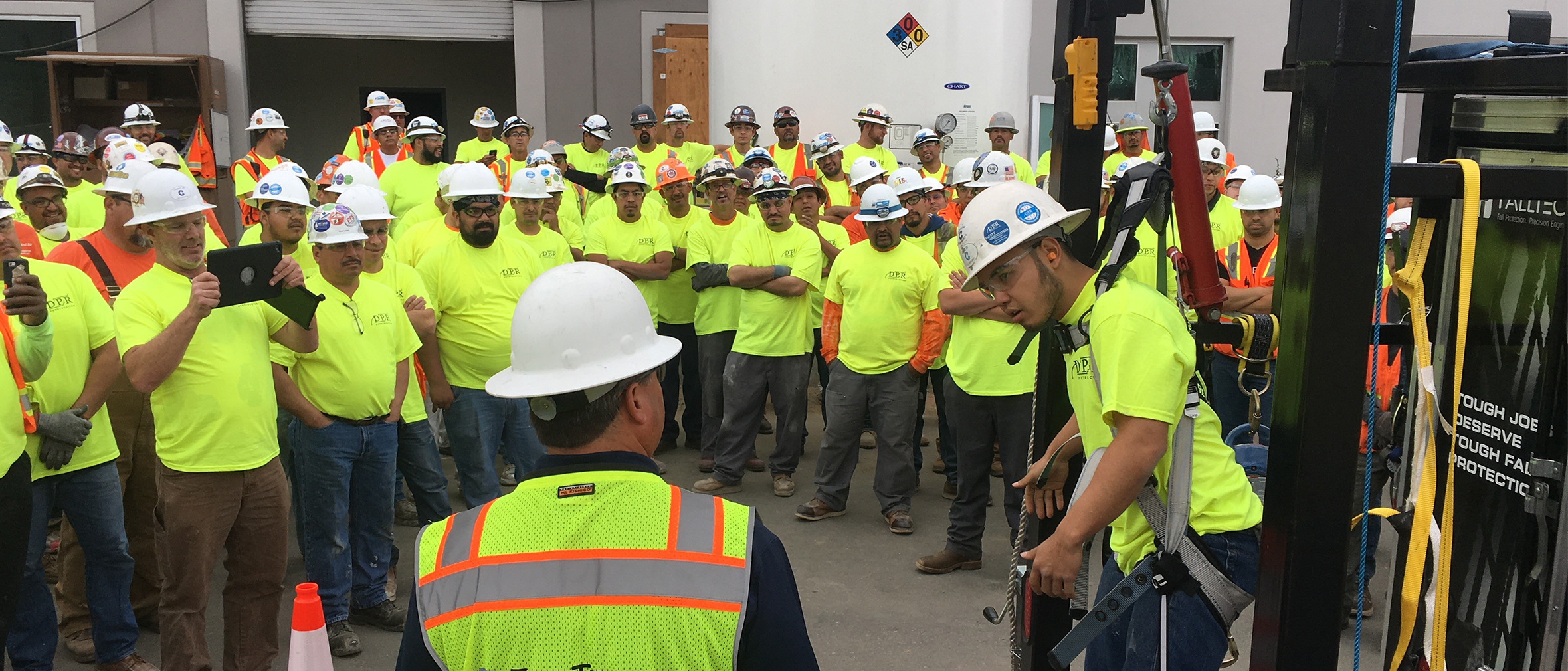 FallTech Regional Sales Manager Jim Ciandella teaching a group of construction workers the importance of trauma relief when suspended from a fall protection harness