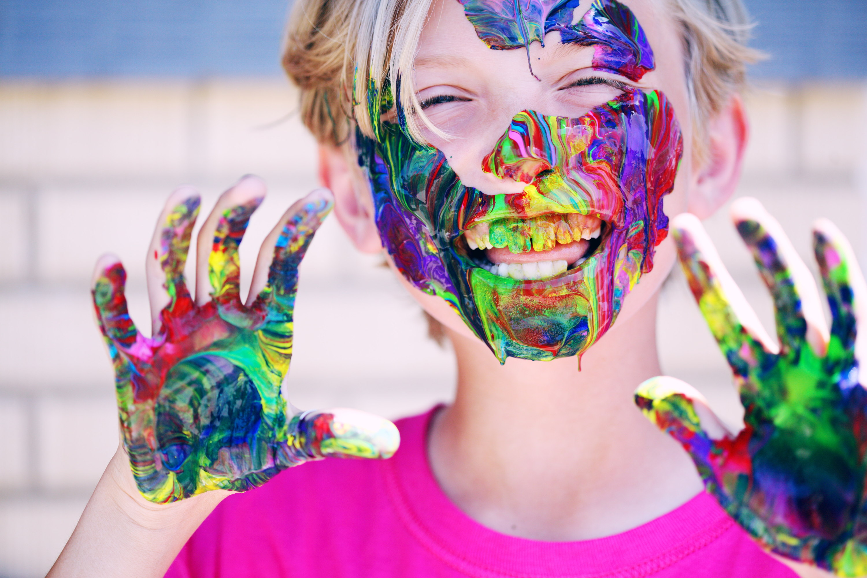 Child playing with paint