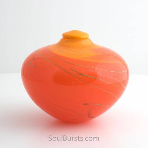 Orange glass urn for ashes