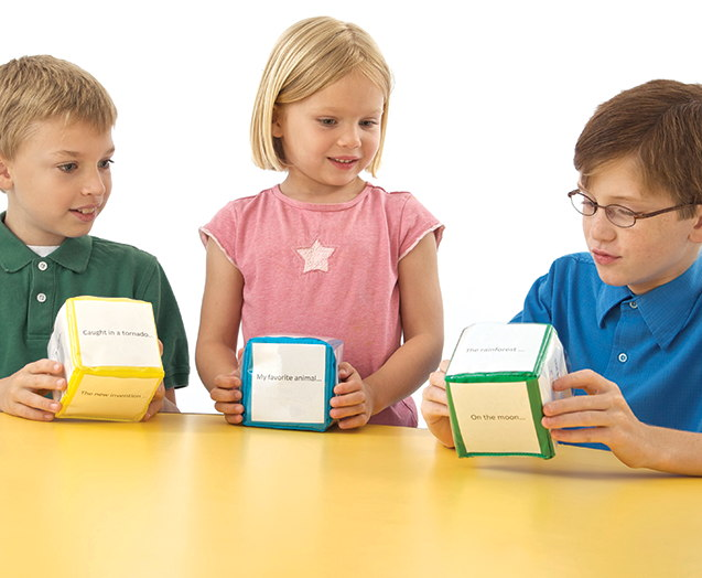 Students in classroom playing with  differentiated instruction cube manipulatives.