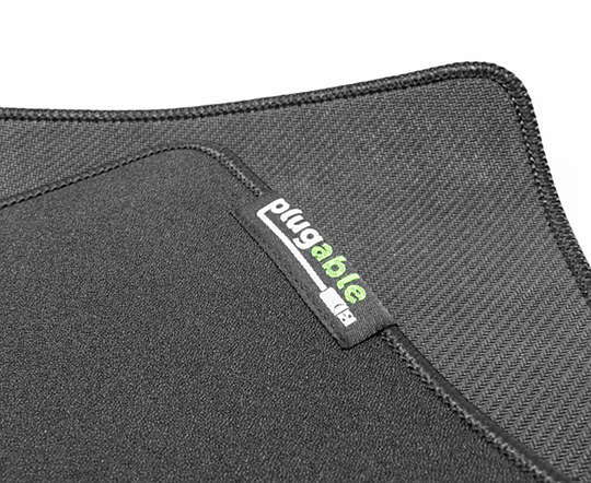 Corner of mouse pad with Plugable logo