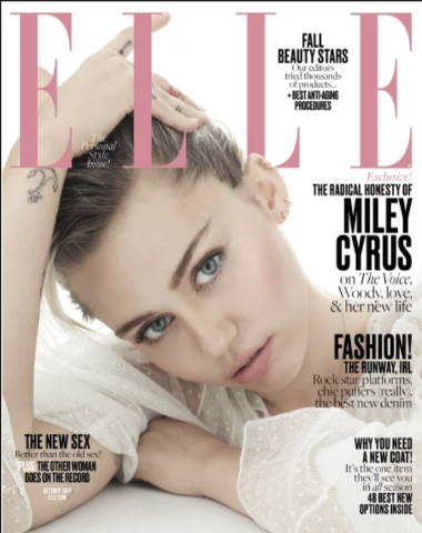 Elle magazine cover, headshot of Miley Cyrus with a serious face in white clothing