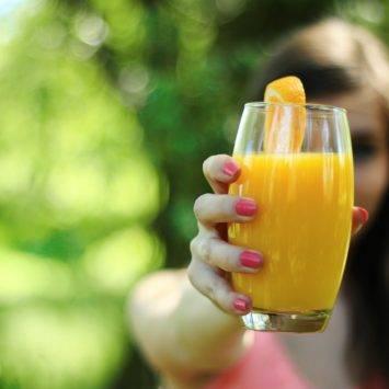 Person Holding Orange Juice