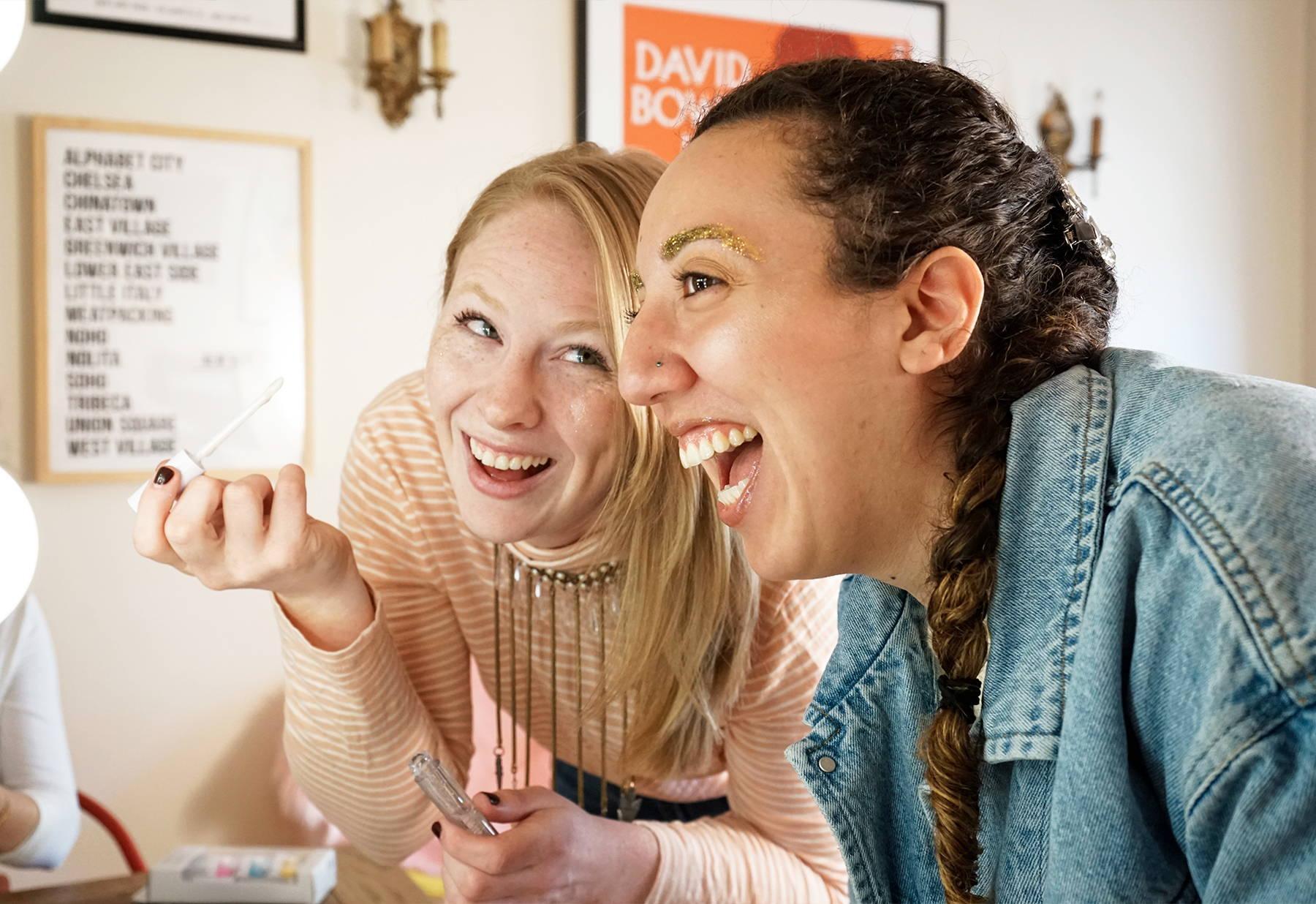 Ashlee and Amanda wear Unicorn Snot glitter gel, holographic glitter lip gloss and lip glitter.