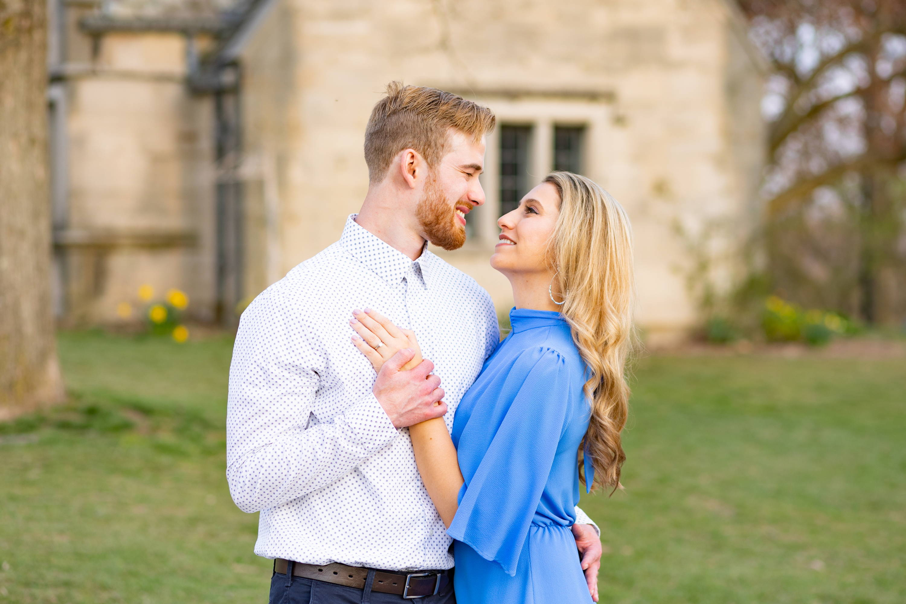 Henne Engagement Ring Couple Kyle & Alyssa Standing in Front of Antique Building