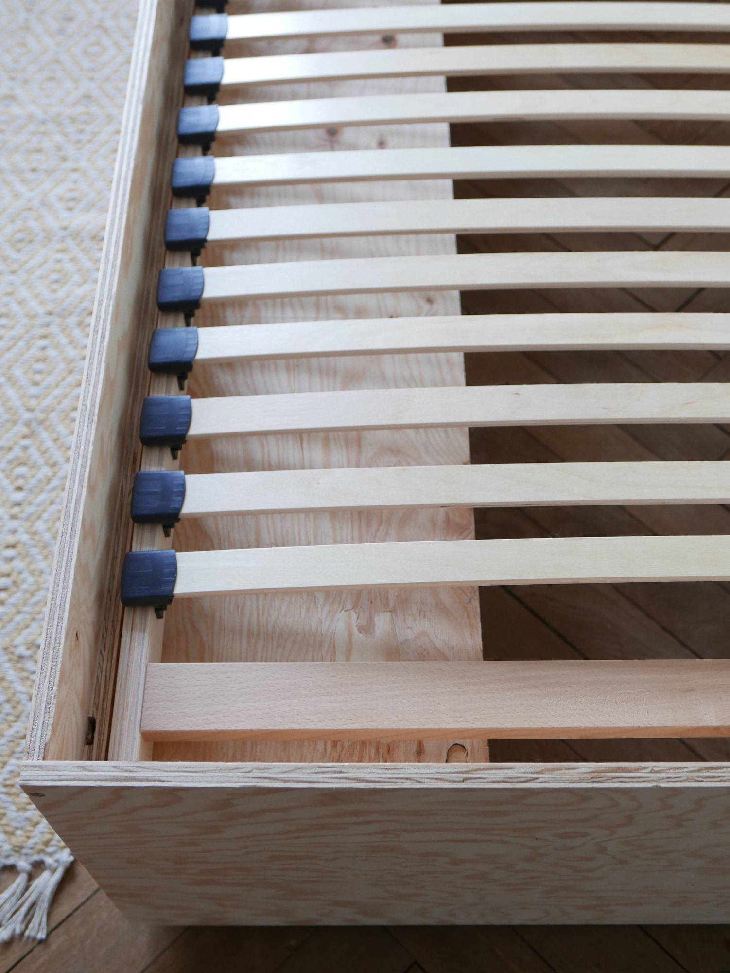 Guest bed construction showing slats