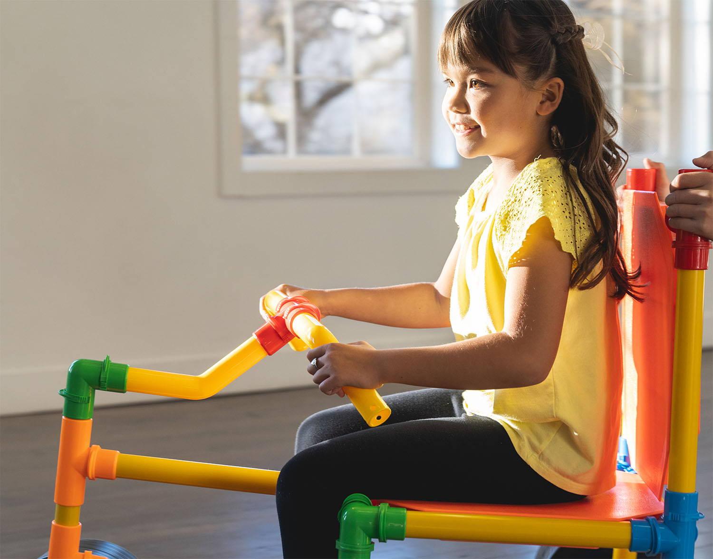 girl on tubelox trike build