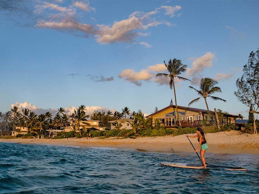 woman paddling the big ez hawaiian vft paddleboard in hawaii