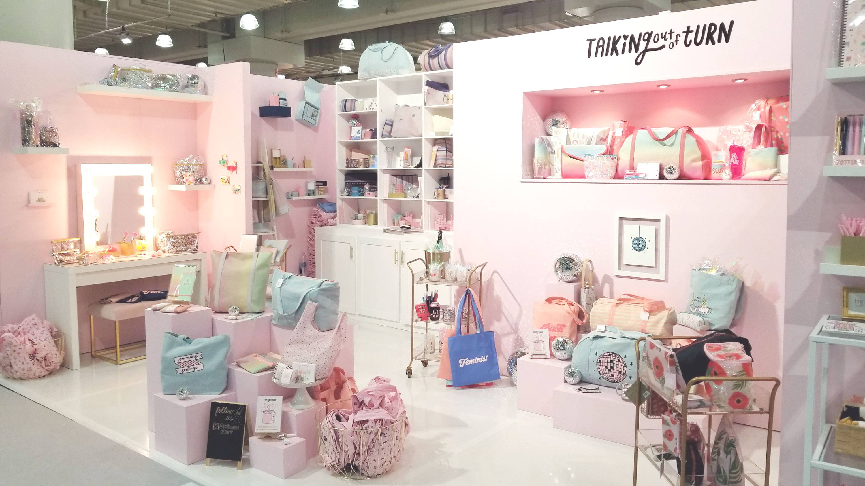 Cute tradeshow booth filled with Toot products like cute tote bags, pencil pouches, and more!