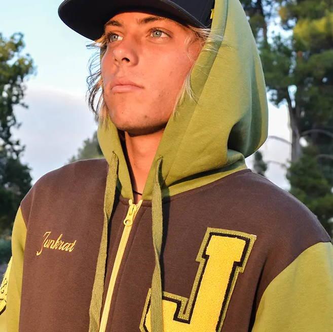 Photo of model wearing the Overwatch Varsity Junkrat Zip-Up Hoodie