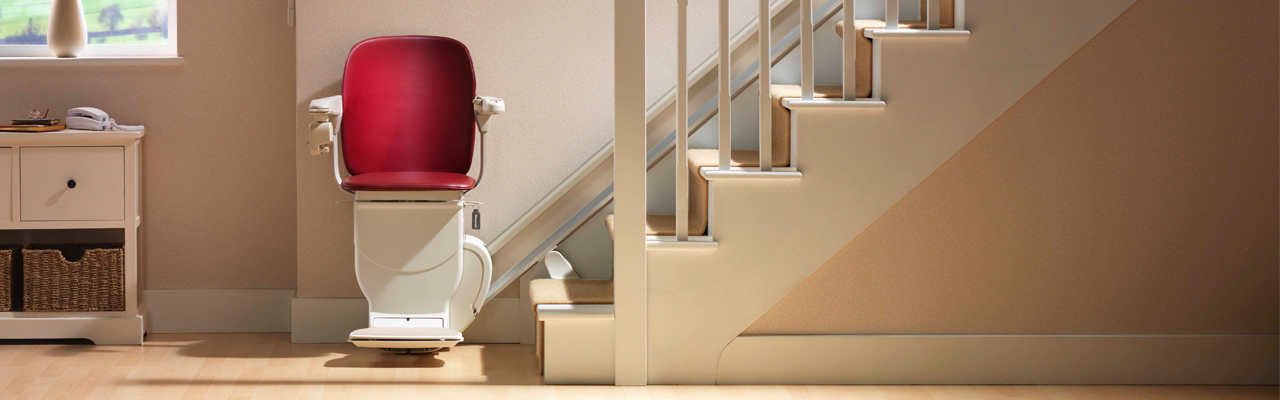 Stannah 600 Siena stairlift cranberry red upholstery banner by VIVA Mobility