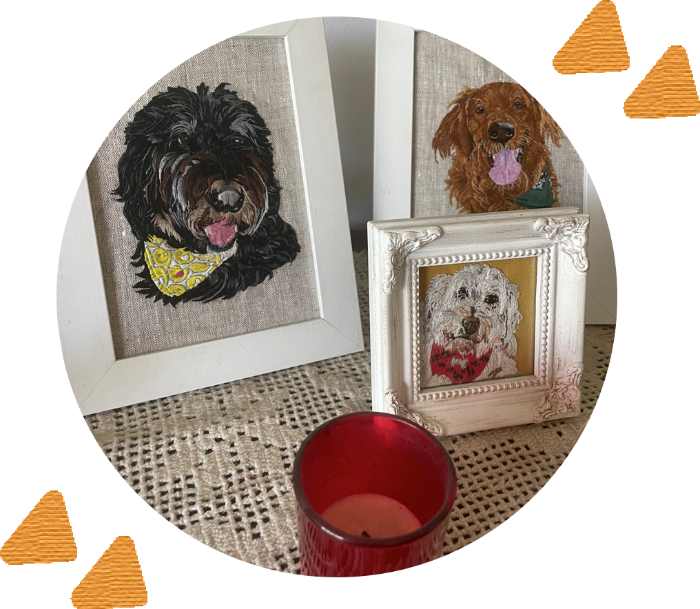 circular photo of white picture frames with dogs embroidered on the inside with abstract yellow shapes surrounding the photo