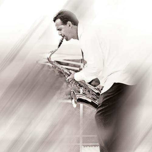 Darren Motamedy playing tenor saxophone