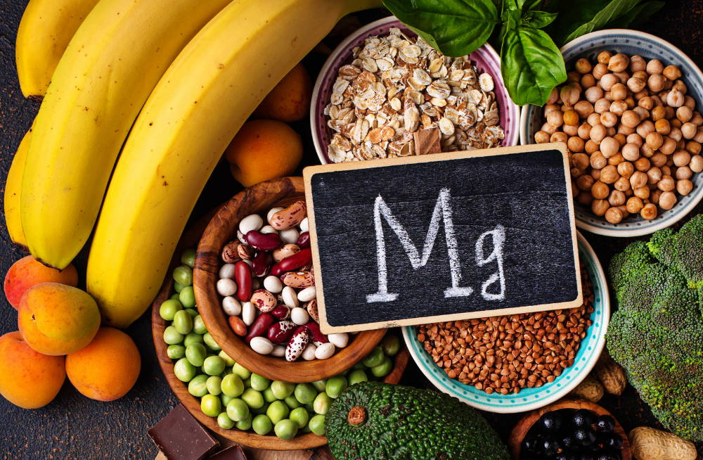 table full of magnesium rich foods with Mg chalkboard|magnesim is essential for enhanced fitness better sleep improved mood