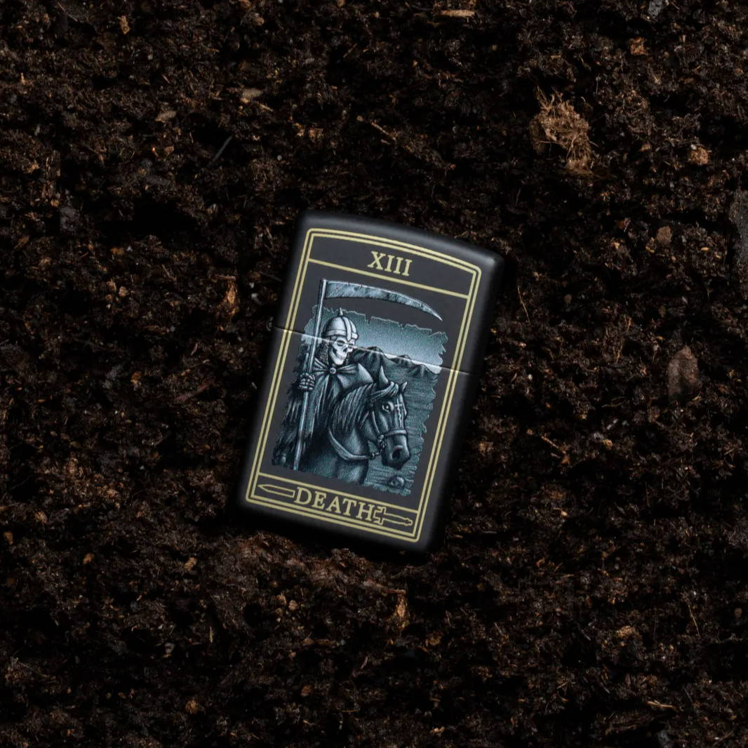 Death Card Design lighter laying in dirt