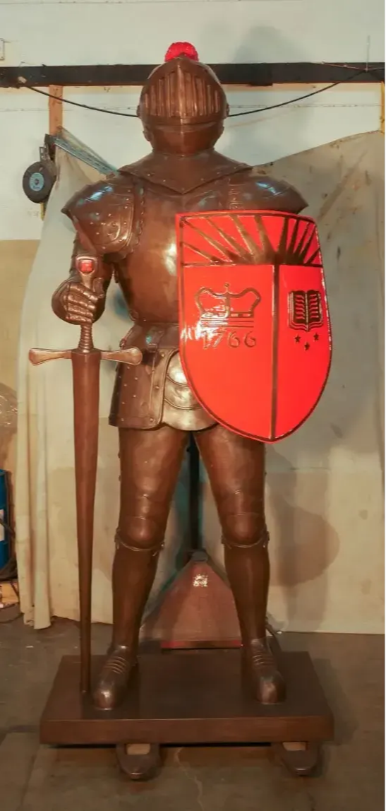 Photo of a Knight holding his shield and sword.